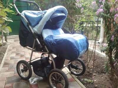 детскую коляску Deltim Вояжер