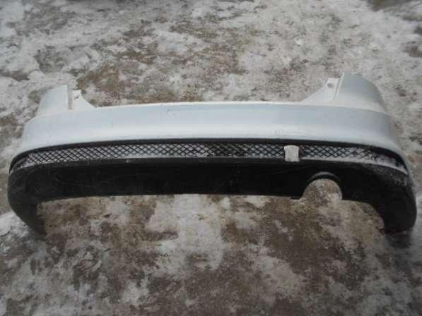Задний бампер со спойлером на Ford Focus III седан
