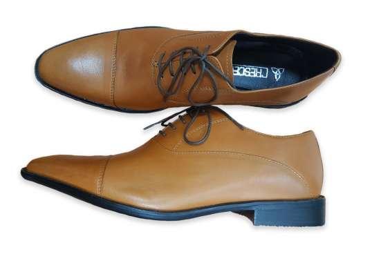 Производство и продажа мужской обуви