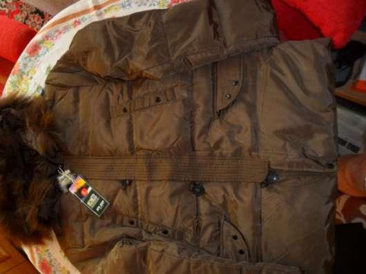 Продаю новый Гонконгский мужской пуховик коричневого цвета