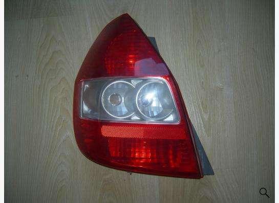 фонарь левый Honda Fit новый